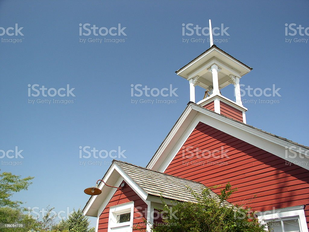 Classic red schoolhouse stock photo