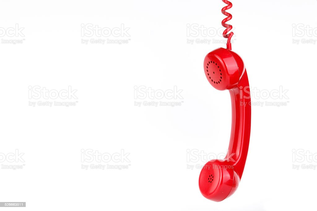 Classic red telephone on white background stock photo