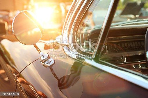 retro vintage red carclassic retro vintage black car. Car mirror. The car is older than 1985