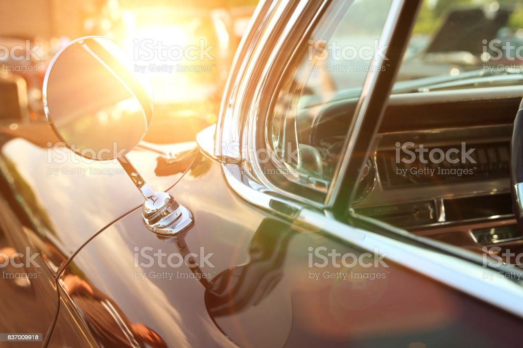 classic retro vintage black car. Car mirror. The car is older than 1985 stock photo