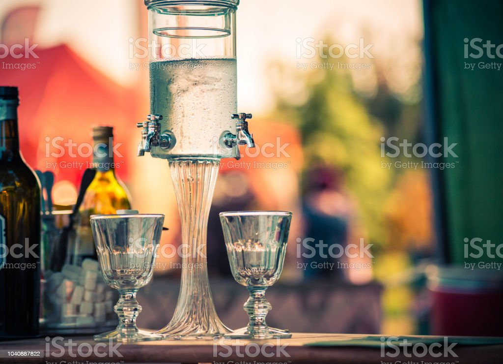 Classic ritual of glass of absinthe and dripping fountain. stock photo