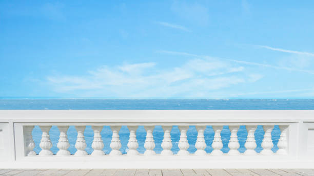 classic roman concrete railing outside building on the terrace pavement floor at the sea view with the blue sky on background stock photo