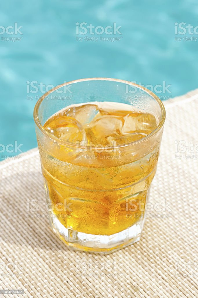 Classic rusty nail cocktail near waterpool on the mat stock photo