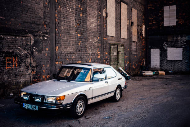Classic Saab Maardu, Estonia - May 1, 2013: Early 80s classic Saab 900 Turbo parked near the wall of old abandoned chemical factory. saab stock pictures, royalty-free photos & images
