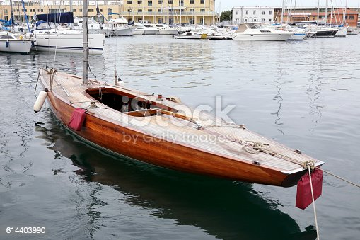 Beautiful old wooden sailboat moored in the Port of Trieste, Italy.