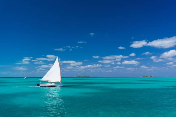 classic sailing boat on sea of abaco - bahamas foto e immagini stock