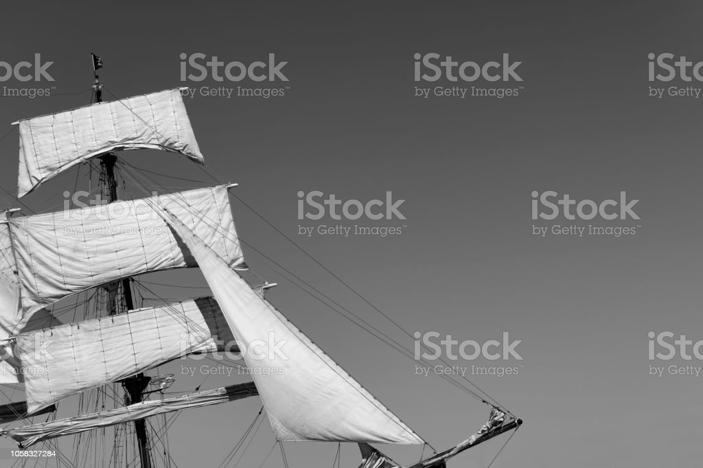 Classic sailing tall ship mast with sails in black and white