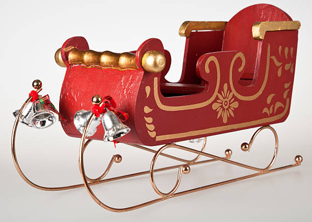 Classic Santa Sleigh Classic Wooden toy Santa Sleigh, with gold trimmings, and silvers bells. sleigh stock pictures, royalty-free photos & images