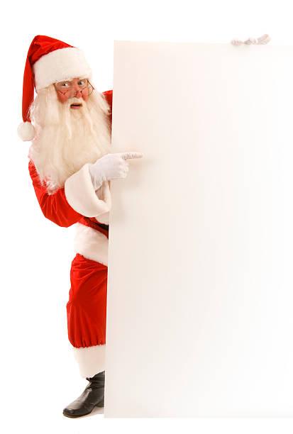 Klassische Santa stehend mit einem Schild. – Foto