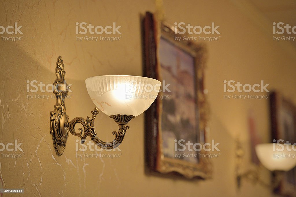 Classic sconce on the wall stock photo