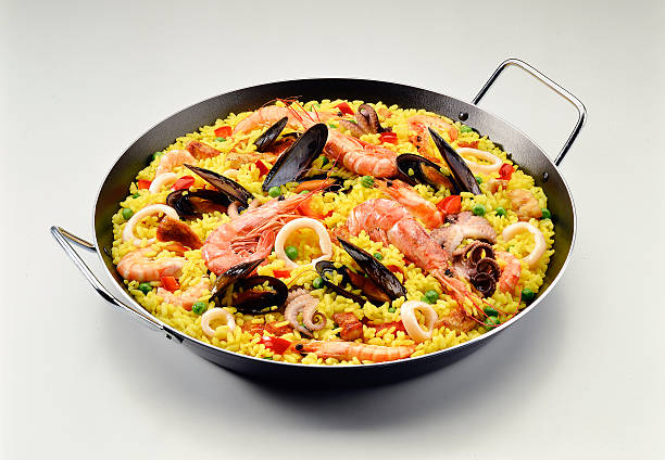 classic seafood paella - paella stock photos and pictures