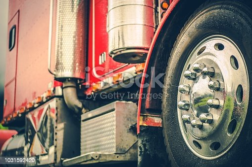 Classic Red Semi Truck Closeup Photo. Trucking Theme. Cargo and Shipping Industry.