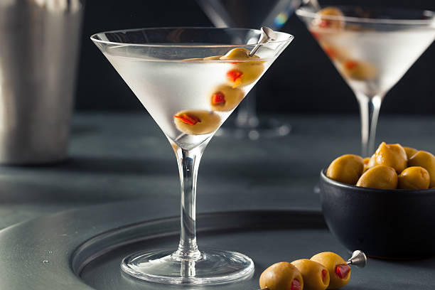 Classic Shaken Dry Vodka Martini Classic Shaken Dry Vodka Martini with Olives martini stock pictures, royalty-free photos & images