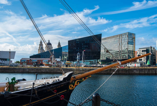A classic ship set against the Liverpool cityscape at the Liverpool Docks, Port of Liverpool, on a beautiful summer afternoon stock photo