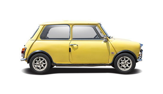 Small British classic car side view isolated on white