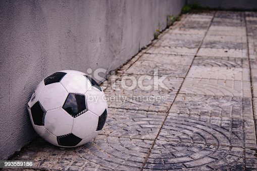 611897876istockphoto classic soccer ball near the gray wall 993589186