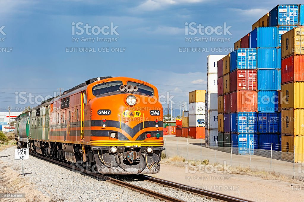 Classic Streamliners with grain train and container stockpile stock photo