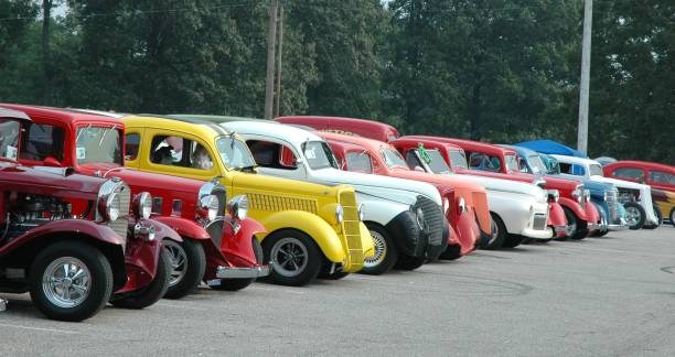 classic street rod automobile lineup at frog follies car show - classic cars stock photos and pictures
