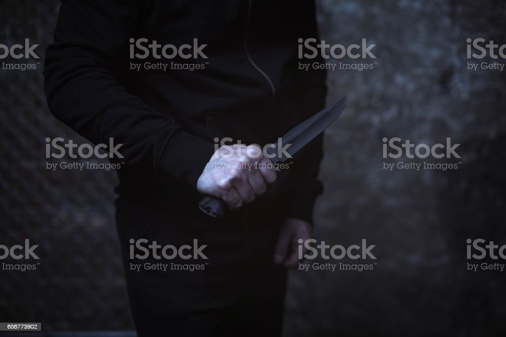 Classic street villain holding up a knife stock photo