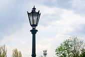 Classic style city lamppost at sunset, close-up