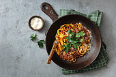 Classic Tagliatelle with Sauce Bolognese. Flat lay top-down composition on concrete background