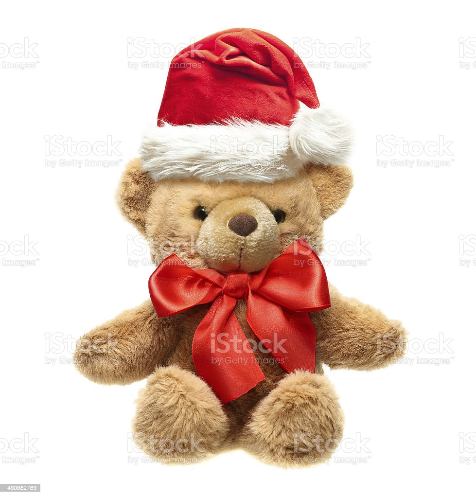 Classic teddy bear with red bow and Santa hat. stock photo