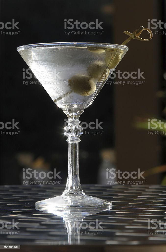 Classic three olive martini on a table top royalty-free stock photo