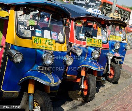 Bangkok, Thailand - January 28, 2020: Three Tuk Tuk Taxis Parked on the Roadside in Bangkok, Thailand