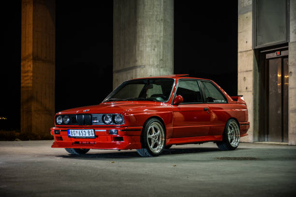 BMW M3 classic versus new model BMW classic versus new model, colorful, classic cars, new model, two cars in the same photo. Photos was made in Serbia with idea to compare same model of the car from past century and newer age. Photo was made in november 2015 and on the photo is very rare classic BMW M3. Idea was to present design and concept from the past comparing to modern BMW M3 from 21 century. Photographed outdoor under the bridge in Belgrade, Serbia. bmw stock pictures, royalty-free photos & images