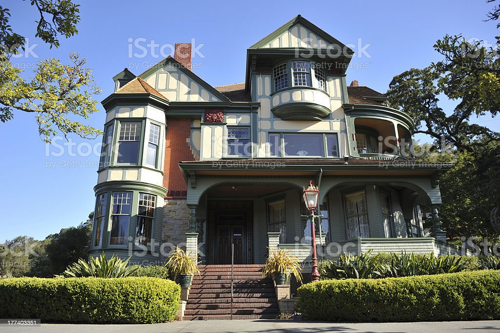 Classic victorian house with hedge in front stock photo
