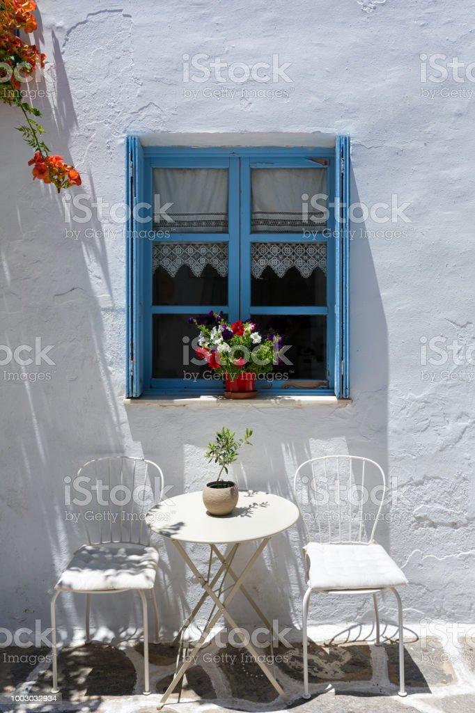 Enjoyable Classic View Of A Greek Blue Window With Coffee Table And Machost Co Dining Chair Design Ideas Machostcouk