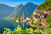 Classic postcard view of famous Hallstatt lakeside town in scenic golden morning light on a beautiful sunny day in summer, Salzkammergut region,  Upper Austria, Austria
