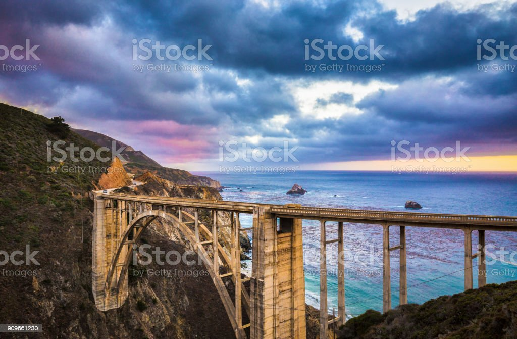 Classic view of historic Bixby Bridge along famous Highway 1 in twilight, Big Sur, California, USA stock photo