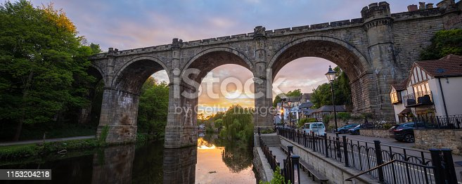 classic view of the railway viaduct architecture over the river Nidd valley in the market town of Knaresborough in North Yorkshire England