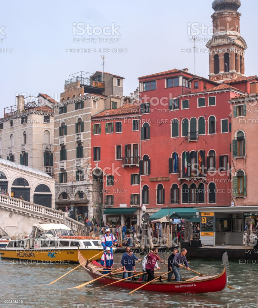 Classic view of the Venetian canal. In the foreground, the training of oarsmen on a gondola. stock photo