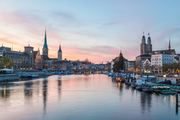 Classic views of the Zurich Skyline at sunset Classic views of the Zurich skyline at long the Limmat river at sunset. The Grossmünster, Fraumünster and St. Peter Church can be seen. zurich stock pictures, royalty-free photos & images