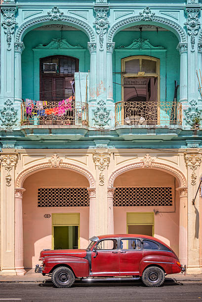 classic vintage car and coloful colonial buildings in old havana - cuba stock photos and pictures