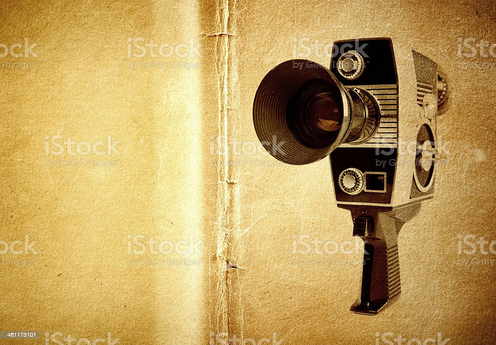 Classic Vintage Video Camera on Grunge Paper stock photo