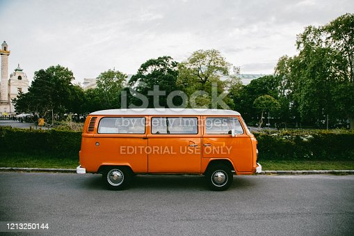 istock Classic Volkswagen Camper Van in White And Orange 1213250144