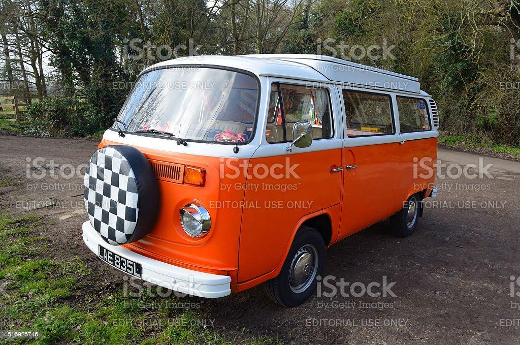 Classic Volkswagen Camper Van in White and Orange. stock photo