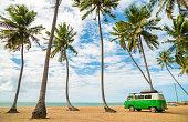 istock Classic Volkswagen Kombi Van on beach 1023528402