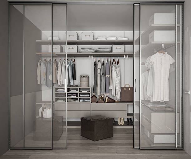 Classic walk in closet with glass sliding doors - foto de stock
