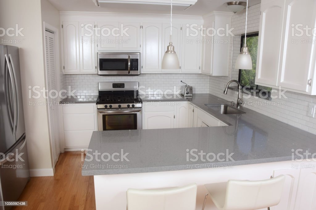 Classic White Domestic Kitchen With Subway Tile And Quartz Counters  Royalty Free Stock Photo