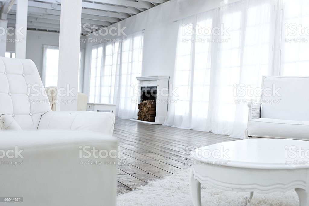 classic white living room with fireplace royalty-free stock photo