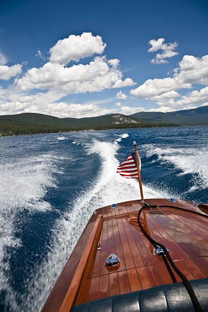 Classic Wooden Boat Wake stock photo