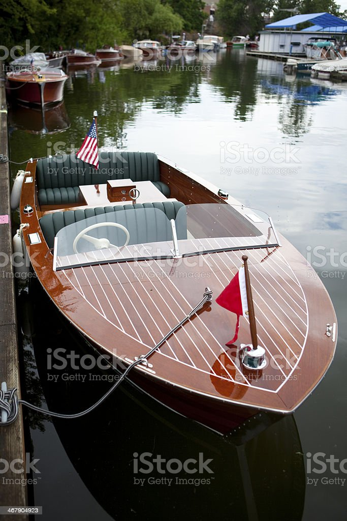 Classic wooden boats lined up at a show stock photo