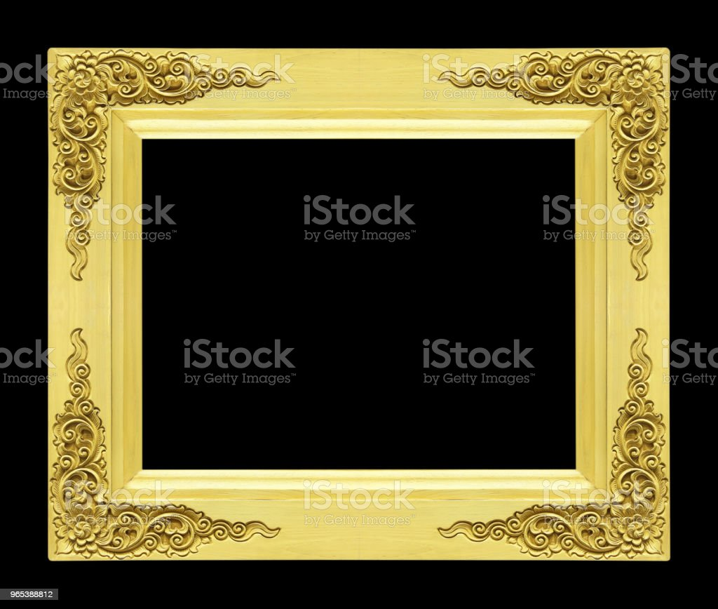 Classic wooden frame isolated on black background, gold color zbiór zdjęć royalty-free