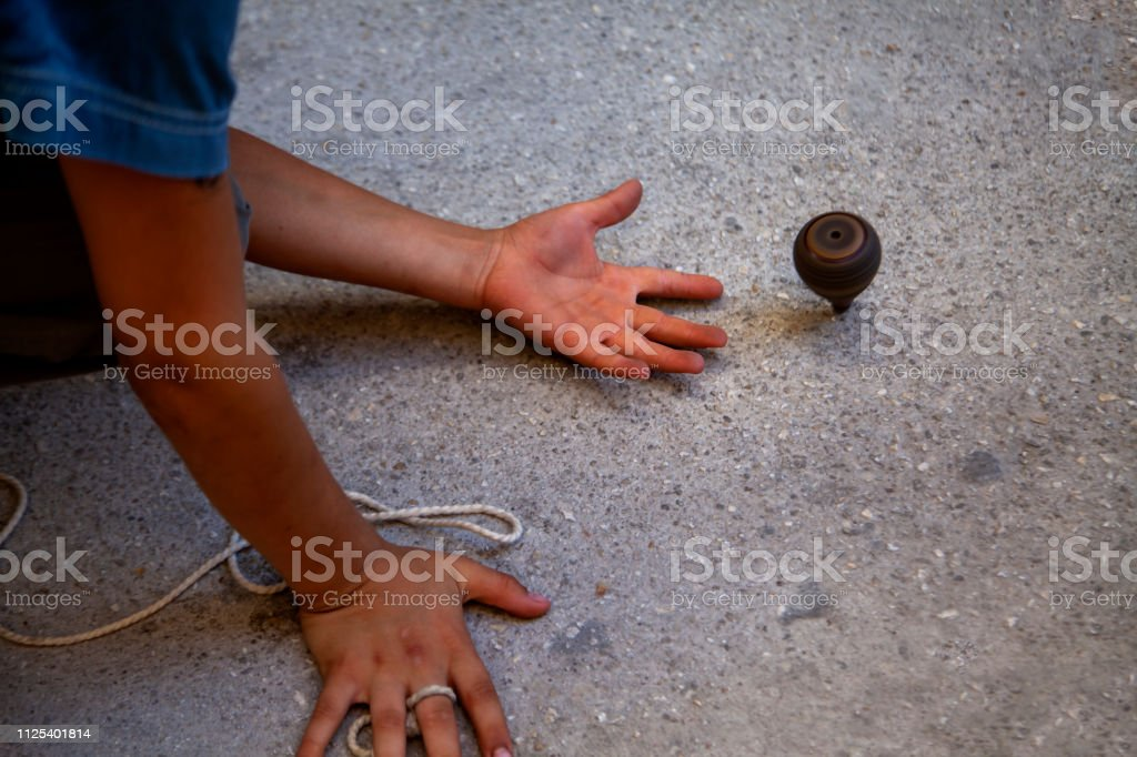Classic wooden top toy with string, stock photo