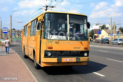 Grodno, Belarus - August 26, 2009: Yellow Ikarus 260 as a city bus of line 17 standing on the bus stop in Grodno. Ikarus was produced in Hungary from 1972 to 2002