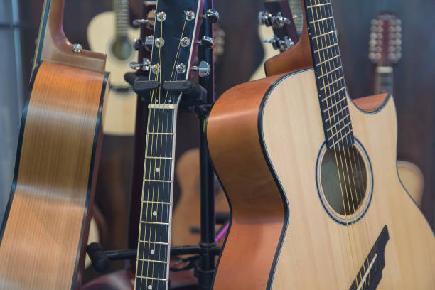 Classical acoustic guitars in musical store. Music Classical acoustic guitars in musical store. Music folk music stock pictures, royalty-free photos & images